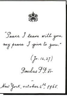 Voici une photo de la signature de Paul VI