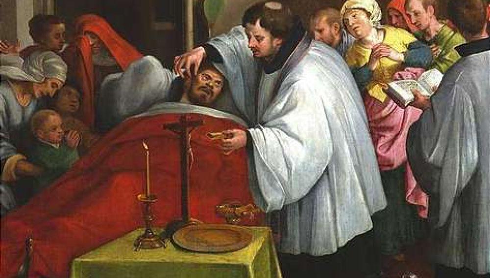 Le sacrement d'extrême-onction administré par un prêtre catholique traditionnel